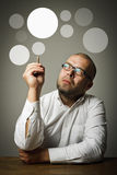 Creator. Man in white and gray bubbles. Stock Photos