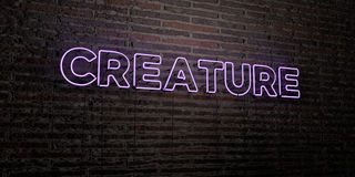 CREATURE -Realistic Neon Sign on Brick Wall background - 3D rendered royalty free stock image Royalty Free Stock Photos