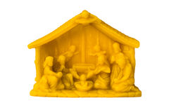 The creche made from beeswax isolated. The creche with baby jesus made from beeswax isolated on white background stock images