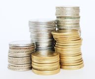 Crecimiento de dinero con oro y monedas de plata Imagen de archivo