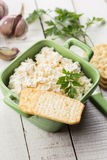 Creckers and cottage cheese with garlic and herbs. Stock Photography