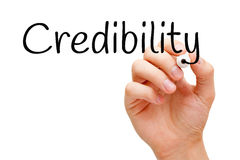 Credibility Black Marker. Hand writing Credibility with black marker on transparent wipe board Royalty Free Stock Images