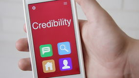 Credibility concept application on the smartphone. Man uses mobile app. stock footage