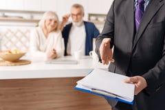 Credible social security advisor demonstrating document for elderly couple stock images