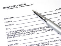 Credit Application. A credit application with a pen laying on it ready to fill out Royalty Free Stock Photo