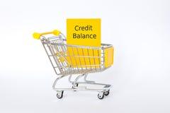 Credit balance shopping cart yellow Stock Photography