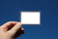 Credit card. Hand holding empty credit card with sky in background Stock Photo
