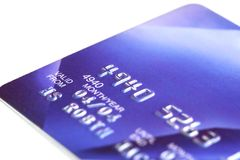Credit Card. Blue credit card, with shallow DOF, white background stock images