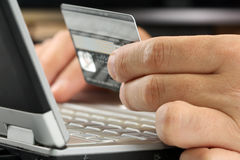 Credit card. E-commerce On-line. Credit card in men hand while payment on-line Royalty Free Stock Image