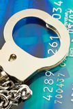 Credit Card. Close to Credit Card and handcuffs Royalty Free Stock Photos