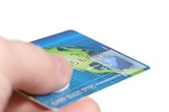 Credit card. Paying a bill by credit card; holding credit card Royalty Free Stock Photo