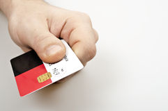 Credit card. Male hand holding credit card Royalty Free Stock Photography