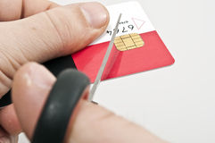 Credit card. Male hand cut credit card Royalty Free Stock Image