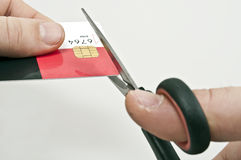 Credit card. Male hand cut credit card Stock Photo