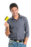Credit card. Happy smiling young man holding a credit card isolated on white background