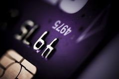 Credit card. On dark background purple tone Stock Photo