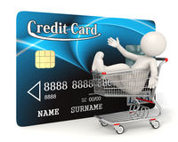 Credit card - 3d man - Shopping cart. 3d guy sitting in a realistic shopping cart in front of a blue credit card - Image on white background with soft shadows Royalty Free Stock Photo