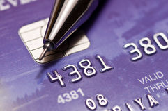 Credit card. Close-up a pen over credit card Stock Image