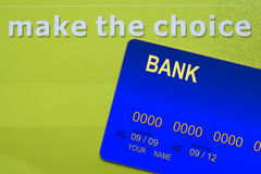 Credit Card. Blue credit card on green background with words make the choice Stock Photos
