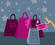 Credit card. Cartoon picture featuring shopping bags and a female hand with a credit card Stock Images