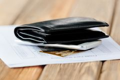 Credit card account statement with two cards. And black leather wallet Stock Image