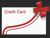 Credit card as a gift. Isolated grey Royalty Free Stock Photos