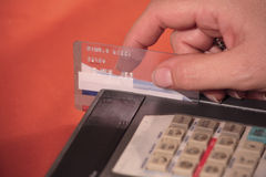 Credit Card or ATM Purchase. Swiping a credit card on a POS machine Royalty Free Stock Photography