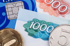 Credit card, banknotes and coins Stock Images
