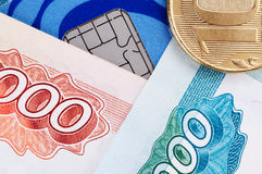 Credit card, banknotes and coins Royalty Free Stock Photos
