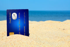 Credit card on the beach Stock Photography