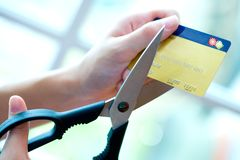 Credit card being cut by big pair of scissors Royalty Free Stock Image