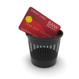 Credit card in a black trash Stock Images