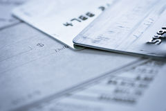 Credit Card Blank Check on Financial Documents. Credit cards and blank check on financial documents. Selective focus on dollar sign on credit card edge Stock Photo