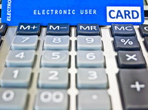 Credit card on a calculator. Stock Images