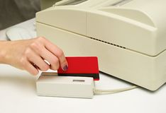 Credit card  in card reader Stock Images