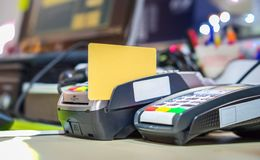 Credit card on card reader machine Royalty Free Stock Photo