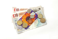 Credit card and cash. Close up of British currency, credit card, notes and coins Stock Photo