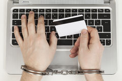 Credit card cheater with handcuff Stock Photos