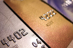 Credit card choice. Three credit cards close-up, diagonal perspective, focus on the first digits. Silver, gold, normal card Royalty Free Stock Image