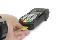 Credit card. Close up of businessman hand insert credit card in credit card reader machine Stock Photos