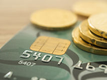 Credit card. Close-up credit card with golden coins in background. selective focus Royalty Free Stock Image