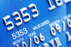 Credit Card Closeup. Macro of digits on a blue credit card royalty free stock photo