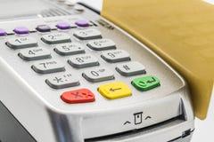 Credit Card. Closeup of credit card and card reader machine Stock Photos