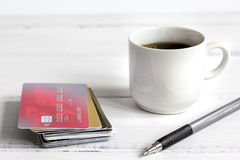 Credit card and coffee cup on wooden background Stock Images
