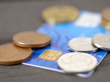 Credit card and coins Stock Photos