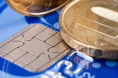 Credit card and coins. Macro Stock Photos