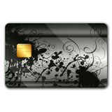 Credit card with colorful oranaments. On it and microchip Stock Image
