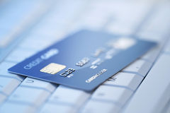 Credit card on computer keyboard Royalty Free Stock Photography