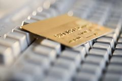 Credit card on computer keyboard Stock Photos