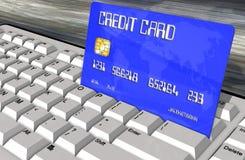 Credit card on computer keyboard closeup Royalty Free Stock Images